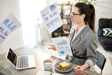 Businesswoman Throwing Papers Imagens