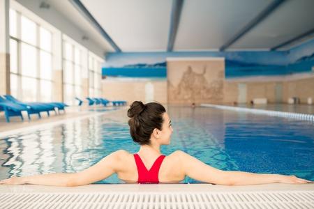 Sportswoman in water Stock Photo - 117527169