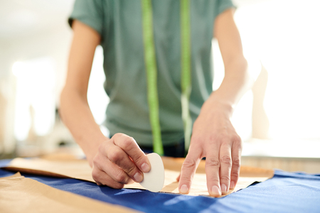 Seamstress with chalk Stock Photo