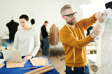 Working in tailoring shop Stock Photo