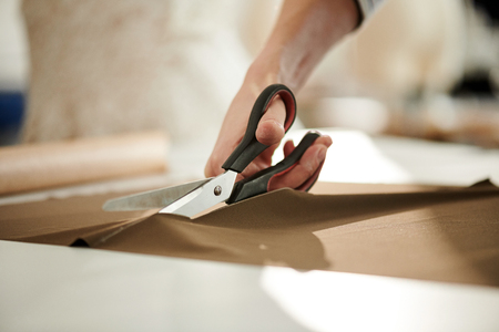 Cutting fabric Stock Photo
