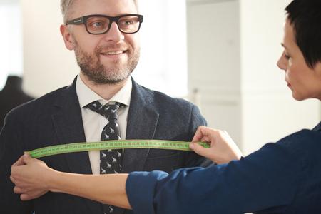Man visiting tailor