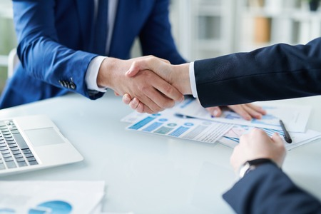 Handshaking over desk