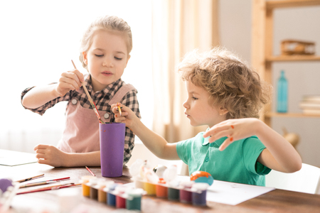 Kids with paintbrushes