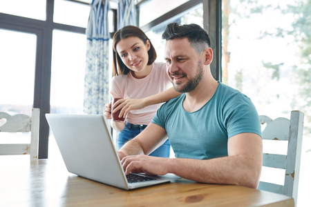 Couple by laptop