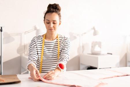 Young seamstress at work Stock Photo