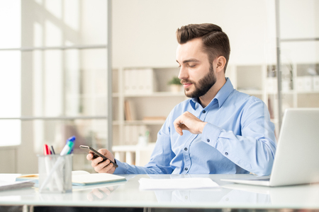Manager with smartphone