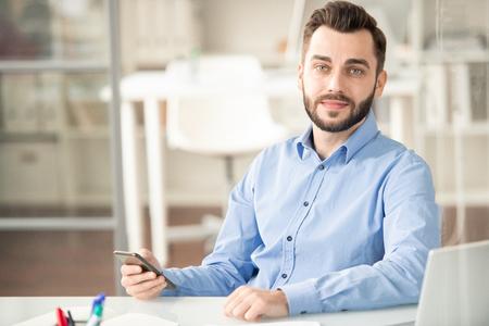 Employee with smartphone Reklamní fotografie