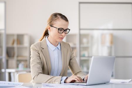 Busy woman preparing presentation on laptop