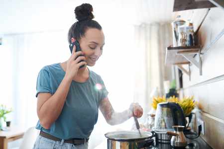 Busy housewife Stock Photo - 121190521