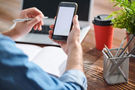 Manager using smartphone Reklamní fotografie