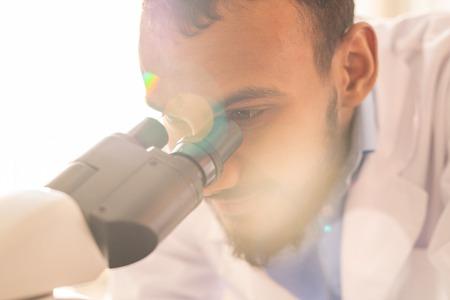 Arabian scientist studying bacteria