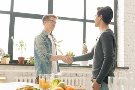 Guys handshaking