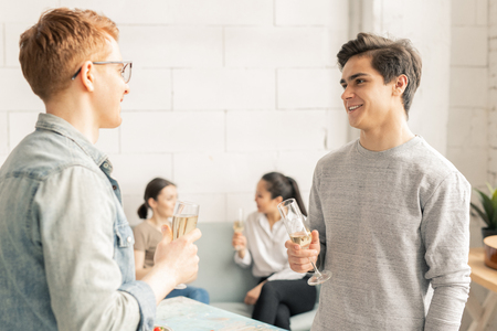Guys with champagne Stock Photo