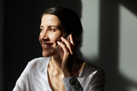 Happy woman with smartphone Stock Photo