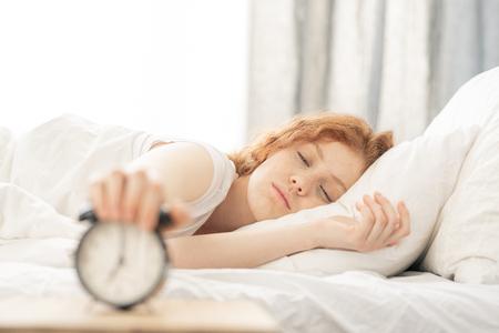 Turning off the alarm Stockfoto
