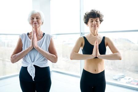 Two women practicing meditation