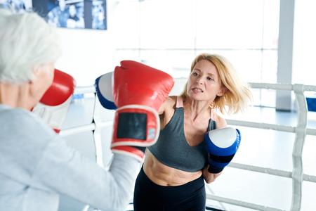 Training on boxing ring Stockfoto