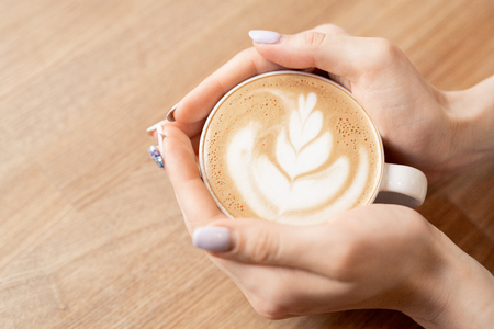 Hands with coffee