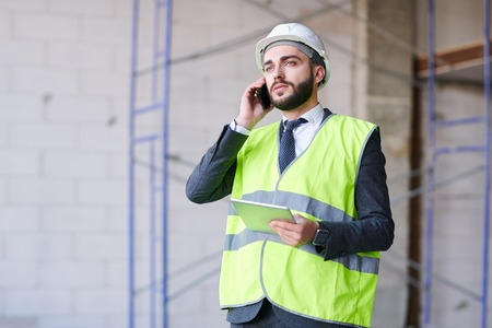 Busy young architect Stock Photo
