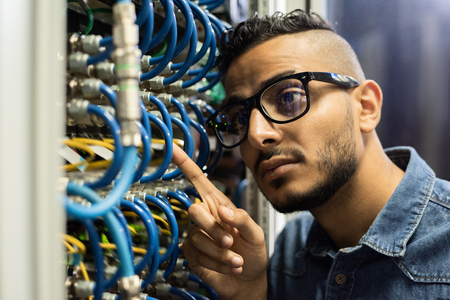 Maintenance engineer examining database server