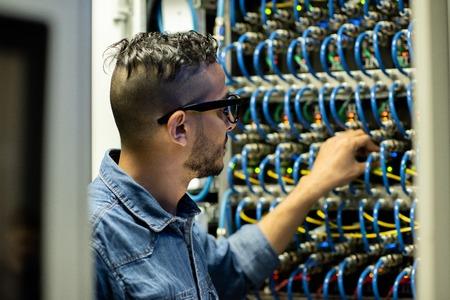Mainframe engineer analyzing system of database storage