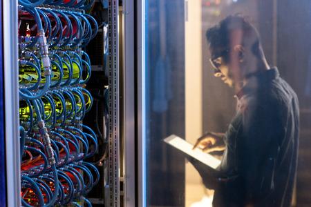 IT engineer testing new supercomputer