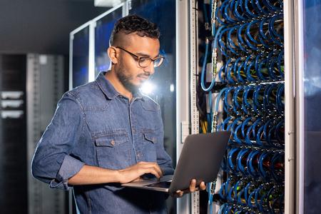 Arabian server engineer using laptop