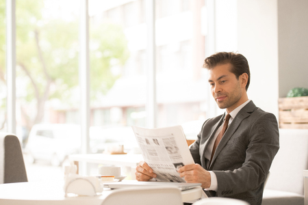 Reading news in cafe Stock Photo