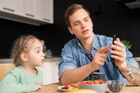 Discussing internet video with daughter Stock Photo