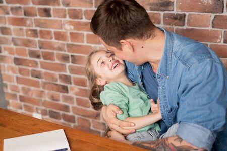 Hugging beautiful daughter