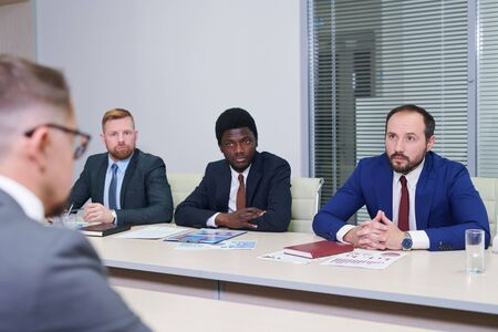 Young intercultural traders interacting with foreign colleagues