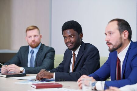 African businessman and his Caucasian colleagues or partners Standard-Bild