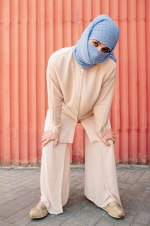 Contemporary young islamic woman in hijab and casual attire