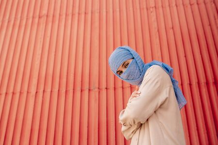 Young muslim woman in hijab crossing her arms on chest