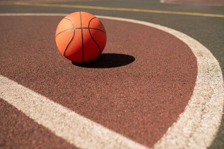 Ball for playing basketball lying on sports field or stadium 版權商用圖片