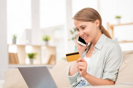 Contemporary girl talking to manager of online shop in front of laptop Stock Photo