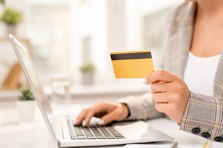 Hand of businessman entering her personal data while making order in online shop