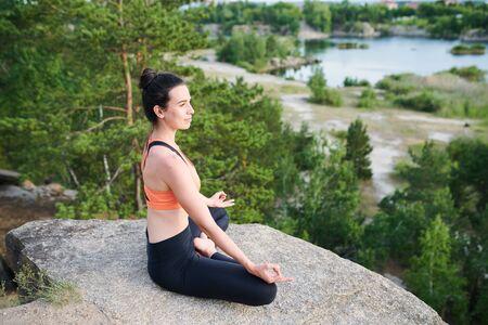 Sitting on stone during meditation