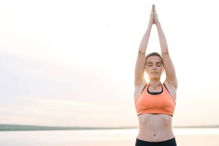 Serene young woman practicing yoga