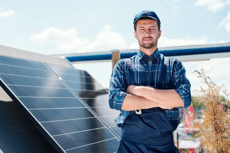 Young successful master of solar panel installation 免版税图像