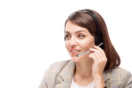 Pretty young polite manager of call center talking to one of clients Banco de Imagens