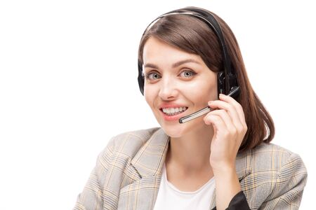 Young smiling hotline consultant in headset answering question of client Banco de Imagens