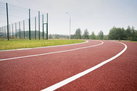 White dividing line making up race tracks in diminishing perspective Stock fotó
