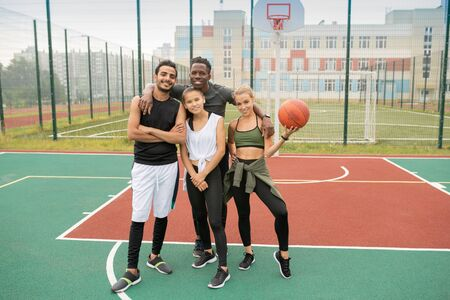 Group of young professional intercultural basketball players in sportswear Standard-Bild