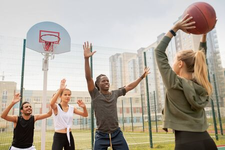Group of intercultural students or friends in sportswear playing basketball Stock fotó