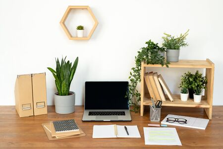 Composition of objects for work of manager, designer or student on desk by wall