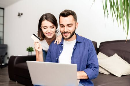 Couple doing online shopping at home
