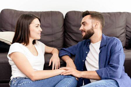 Couple chatting with each other at home