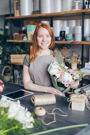 Portrait of smiling florist with bouquet Stok Fotoğraf - 130735405